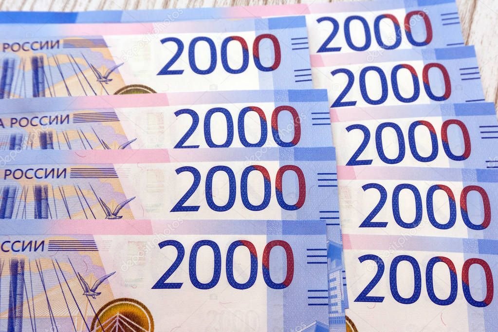 Two thousand rubles with one banknote. New Russian banknote in two thousand rubles in 2017. Cash paper blue money