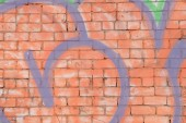 Heart shape shadow on brick wall background