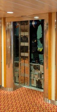 Elevator repair in progress with door open and man standing