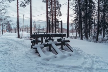Empty gym in the forest mildly covered with some snow
