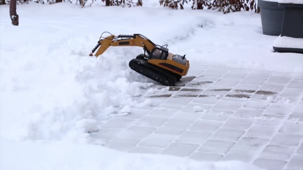 Short film of working radio controlled model excavator car. Free time. Children and adults concept. Hobby. Toys.