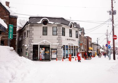 Otaru, Hokkaido, Japan 14 February 2018 : Landscape view of Otaru shopping street and Post office building in European style (Sakaimachi Post Office) on winter heavy snow day.
