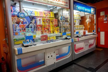 Osaka, Japan, January 16 2019: Perspective view of Japanese dolls figure and cabinet catches machine. Dolls cabinet catches is a coins operated entertainment machine Popular in Japan and Asia.