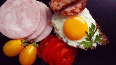 Fried egg and ham for Breakfast.