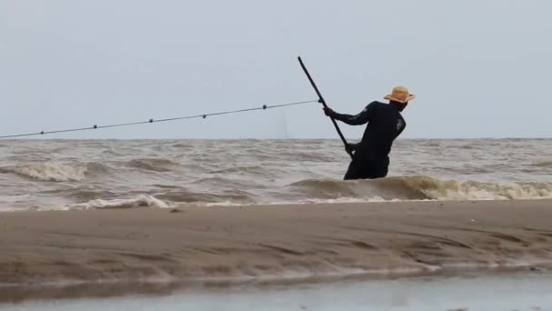 Fisherman Catches Fish At Sea With Net (1 of 8)