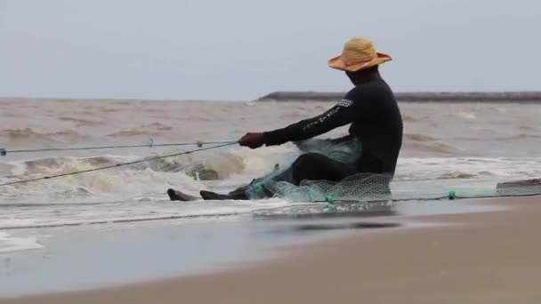 Fisherman Catches Fish At Sea With Net (3 of 8)
