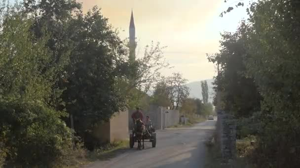 Albanian Town Street With People Riding Horse Drawn Wagon