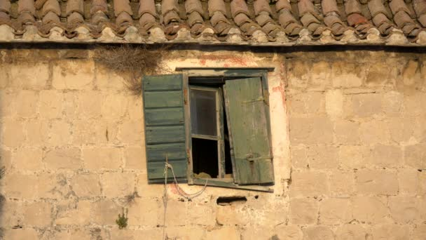Broken Window With Shutters Of Old Abandoned House