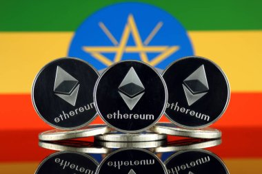 Physical version of Ethereum (ETH) and Ethiopia Flag. Conceptual image for investors in cryptocurrency, Blockchain Technology, Smart Contracts, Personal Tokens and Initial Coin Offering.