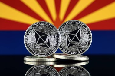 Physical version of Ethereum (ETH) and Arizona State Flag. Conceptual image for investors in cryptocurrency, Blockchain Technology, Smart Contracts, Personal Tokens and Initial Coin Offering.