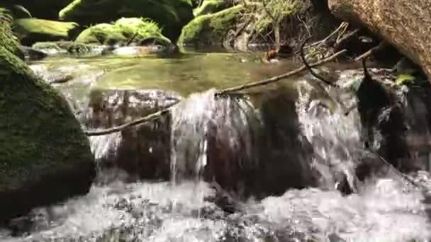 Waterfall flows down the rocks.