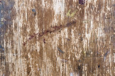 The surface texture of the old easel is stained with paint. Background