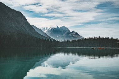 Emerald Lake in Canadian Rockies with mountains and lake and trees. Concept of active vacation and tourism.