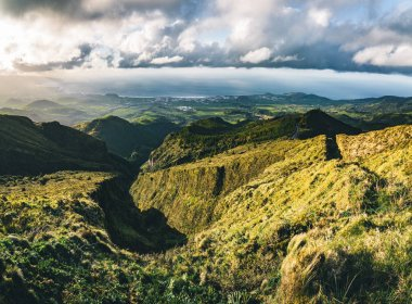 Beautiful panoramic view of Lagoa do Fogo, Lake of Fire, in Sao Miguel Island, Azores, Portugal. Sunny day with blue sky and clouds.