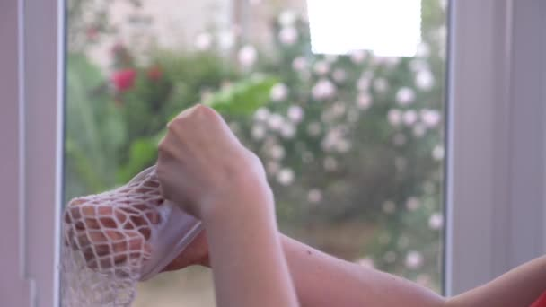 close-up. Female hands test the integrity of kapron stockings. a torn pantyhose, 4k, slow-motion
