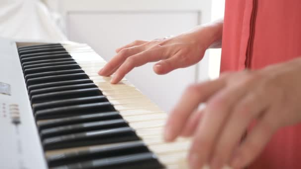 Musician playing synthesizer  the musician plays the piano  female hands  play the synthesizer  4k, slow motion