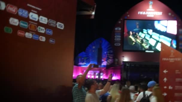 SOCHI, RUSSIA - June 15, 2018: FIFA 2018. broadcast the game on the screen in the seaport. fans are watching the live broadcast of the game.