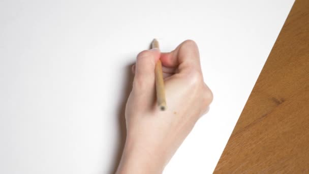 a female hand draws a portrait of a girl. 4k, close-up. Slow motion. view from above.