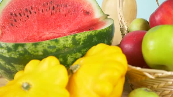 colorful still life. color background. Watermelon, squash, apples. Autumn harvest. 4k.