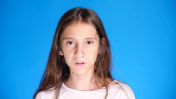 portrait. close-up. Teenage girl on background color. close-up, emotion of fright. 4k, slow motion.