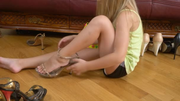 playing with high-heeled shoes