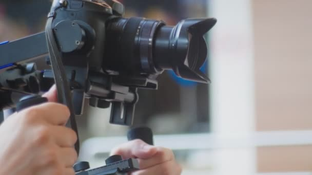 Operator with Steadicam recording video. 4k, operator shoots a video of a girl dancing in the park