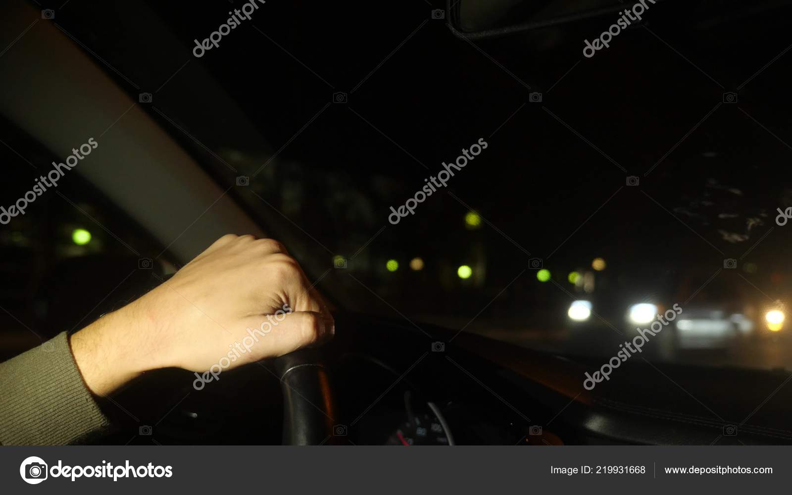 Hand On The Steering Wheel Of The Car Evening Night Time Left Side Traffic Blurred Lights Outside The Window Stock Photo Image By C Expsycholog Gmail Com 219931668
