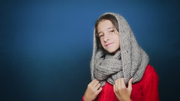 beautiful teen girl in autumn clothes , posing at camera over blue background
