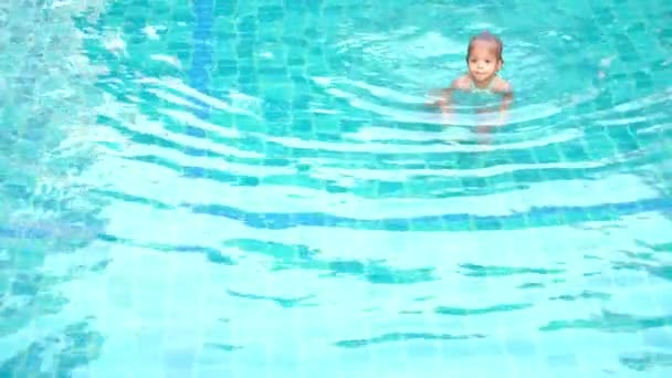 asian cute little girl playing in the pool