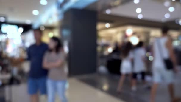 rozmazané pozadí. Abstraktní rozostření interiéru krásné moderní luxusní obchody a prodejny. lidé v mall.