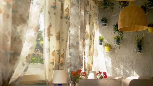 The concept of the interior windows. large full-length windows decorated with floral print curtains and house wall decorated with home plants