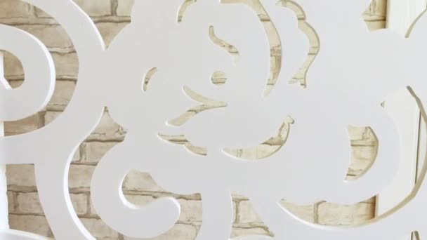 texture background. close-up. view of the white brick wall through the patterns of the decorated room partition