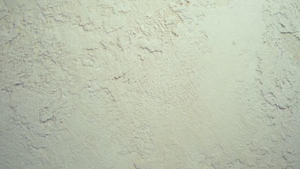 Hintergrundtextur. dekorativ strukturierter venezianischer Gips beige. Nahaufnahme