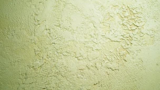Struktura pozadí. dekorativní texturovaná benátská omítka béžová. close-up