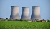 The Chimneys of Didcot power station loom over a village