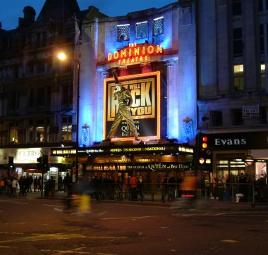 London, United Kingdom - March 08 2004:   Traffic passes under the Statue of Freddie Mercury outside the Dominion Theatre during the run of Queen Musical We Will Rock You
