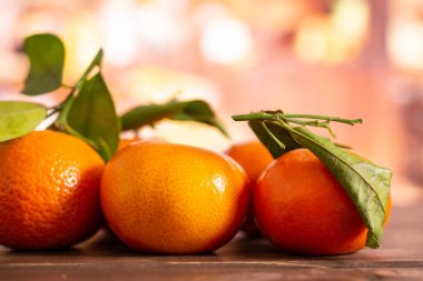 Mandarine with a leaf with rustic kitchen