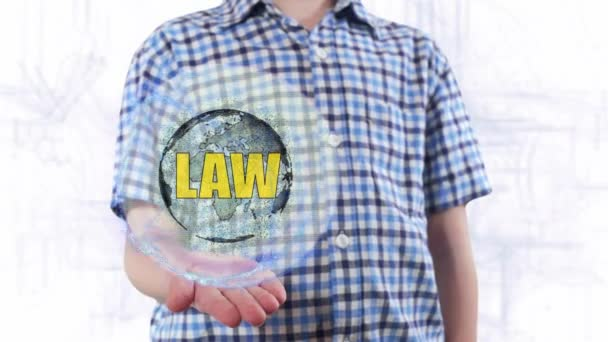 Young man shows a hologram of the planet Earth and text Law