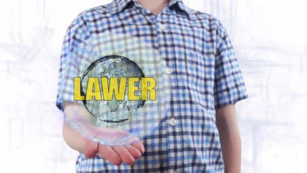 Young man shows a hologram of the planet Earth and text Lawyer