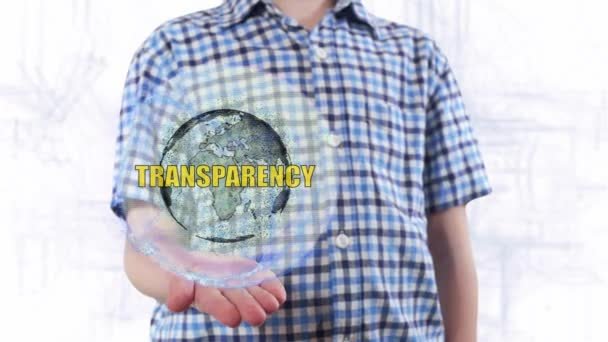 Young man shows a hologram of the planet Earth and text Transparency