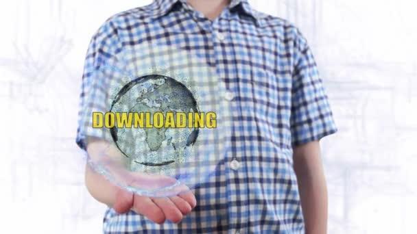 Mladý muž ukazuje hologram planety země a text stahování