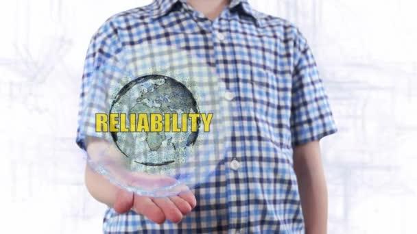 Junger Mann zeigt ein Hologramm des Planeten Erde und Text Zuverlässigkeit