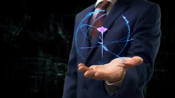 Businessman shows concept hologram 3d rose on his hand