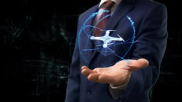 Geschäftsmann zeigt Konzept Hologramm 3d Drone auf seiner Hand