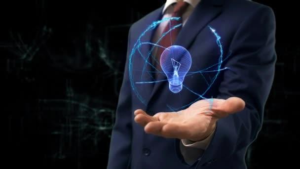 Podnikatel, ukazuje koncept hologram, 3d žárovka lampa na ruce