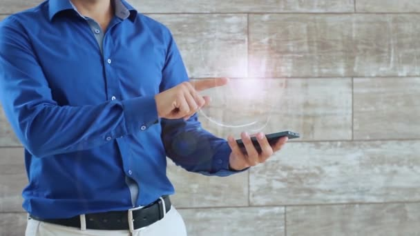Man activates a conceptual HUD hologram with text Lawyer. The guy in the blue shirt and light trousers with a holographic screen on the background of the wall