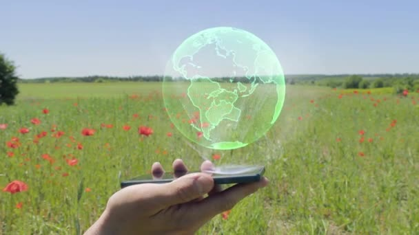 Hologram of Green planet Earth on a smartphone