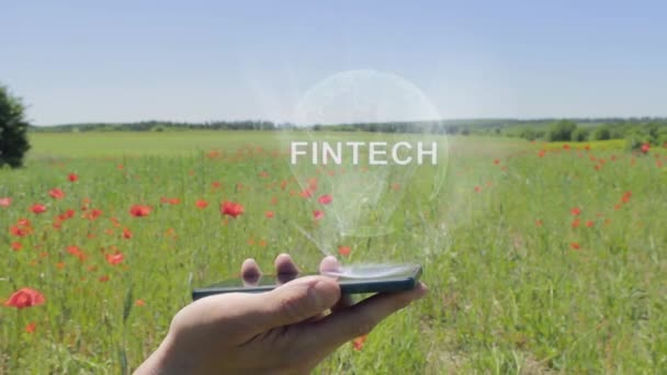 Hologram of Fintech on a smartphone