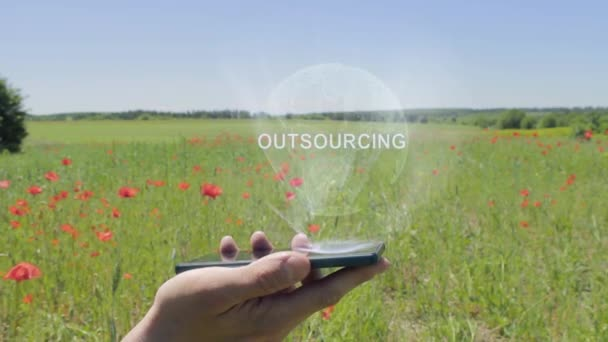 Hologram of Outsourcing on a smartphone