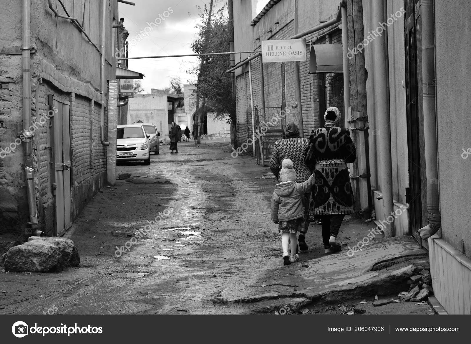 January 2018 bukhara uzbekistan woman girl walking alleyway old city stock photo